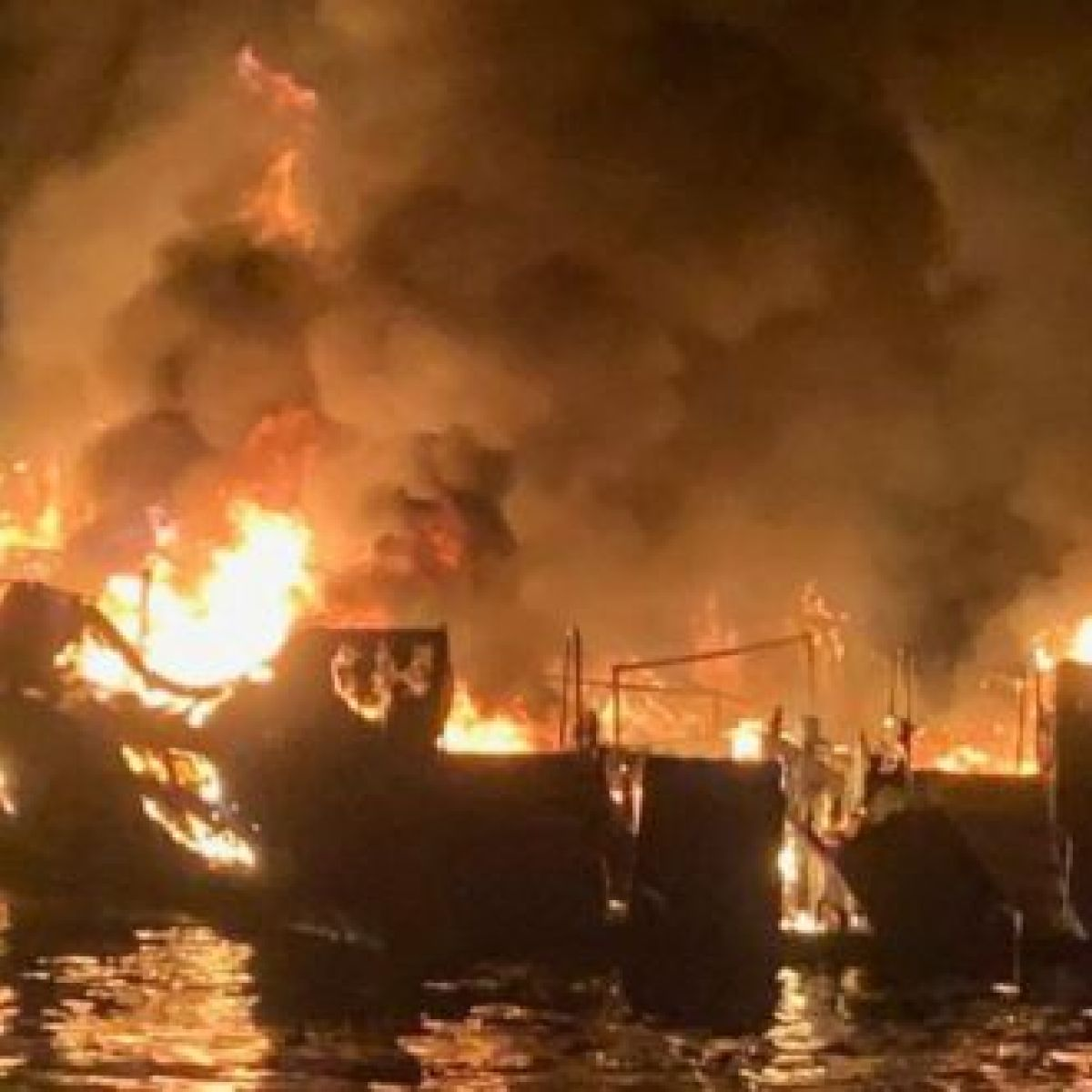 Search for bodies continues after boat fire kills at least 25