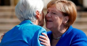 German chancellor Angela Merkel greets incoming ECB president Christine Lagarde at the Leipzig Graduate School of Management. Photograph: Odd Andersen/AFP/Getty Images