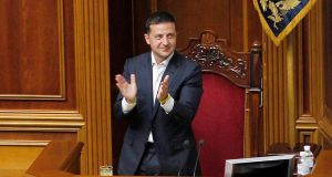 Ukrainian president Volodymyr Zelenskiy applauds after the Ukrainian parliament voted to strip themselves of immunity from prosecution, in Kiev. Photograph: Stepan Franko/EPA