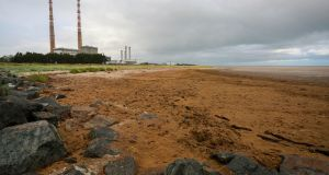 The beach at Shelley Banks, beside Ringsend wastewater treatment plant, covered by a blanket of noxious material. Photograph: Crispin Rodwell/ The Irish Times