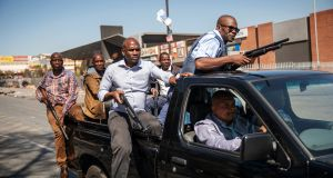 Plain-clothes members of the South African Police Service patrol the Johannesburg township of Alexandra. Photograph: Michele Spatari/AFP/Getty Images