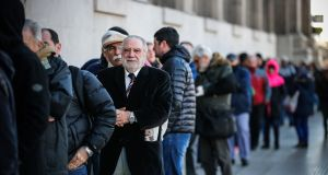 People line up in front of a bank in Buenos Aires on Monday during another day of uncertainty after the financial restrictions promoted by the government. Photograph: Juan Ignacio Roncoroni/EPA