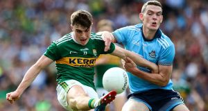 Kerry's impressive Jack O'Shea in action against Brian Fenton who was a subdued figure for once for Dublin in the All-Ireland final at Croke Park. Photograph: James Crombie/Inpho