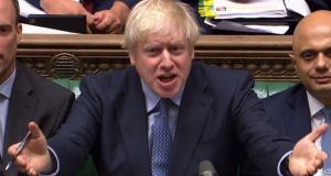 Britain's prime minister Boris Johnson reacting as the opposition Labour Party leader Jeremy Corbyn speaks during prime minister's questions (PMQs) in the House of Commons. Photograph: AFP/Getty