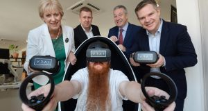 Minister for Business  Heather Humphreys  with Niall Campion and Pat O'Connor, VRAI founders, Enterprise Ireland's Niall McEvoy and Chris McHugh, VRAI's senior VR developer, at VRAI's  new Temple Bar offices. Photograph:  Dara Mac Dónaill