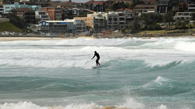 A surfer during large swells at Bondi Beach in Sydney, Australia. Photograph: Joel Carrett/PA