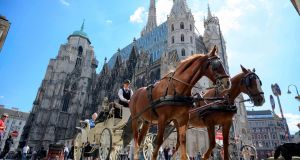 A carriage passes by the St Stephen's cathedral in Vienna, Austria. Photograph: Joe Klamar/AFP/Getty