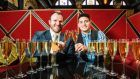 Gavin Carroll, general manager of the Merchant Hotel, Belfast, and bartender Mario De Santis toast the return of the third annual Festival of Prosecco to Belfast's Merchant Hotel