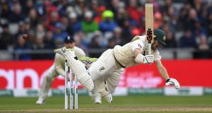 Australia batsman Travis Head  falls after being struck by a  yorker from England's Ben Stokes during the first day of the fourth Test at Old Trafford. Photograph: Gareth Copley/Getty Images