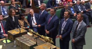 A videograb from footage broadcast by the UK parliament's Parliamentary Recording Unit (PRU)  shows tellers  delivering the result of the vote on the motion to hold an early general election, in the House of Commons in London. Photograph: PRU/AFP/Getty Images