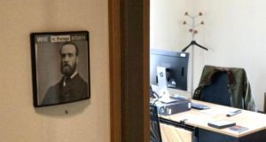 The Victorian gentleman whose portrait is displayed underneath Nigel Farage's name on the door of his Brussels office is of Irish nationalist leader Charles Stewart Parnell.