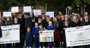 Students of Coláiste Lú, Dundalk along with parents  walk from the school to the LMETB offices to protest about being forced to learn in English. Photograph: Alan Betson