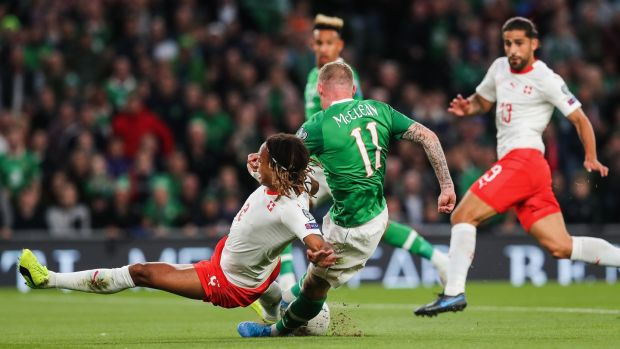 James McClean has a shot blocked by Kevin Mbabu. Photo: Ryan Byrne/Inpho