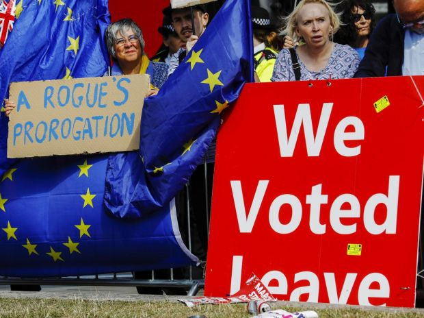 Brexit battle: Remain and Leave demonstrators outside parliament. Photograph: Luke MacGregor/Bloomberg