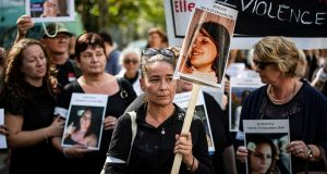 Women hold placards depicting victims as they march to denounce violence against women and femicide, in Paris on Tuesday. Photograph: Ian Langsdon/EPA