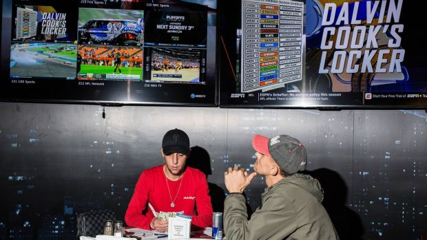 Gamblers prepare to place bets in the restaurant at the Meadowlands Racetrack. Photo: Bryan Anselm/The New York Times