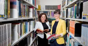 Galina Moraru, a student at Kildare and Wicklow ETB, and author Emilie Pine at the launch of the National Adult Literacy Agency's Take the First Step campaign. Photograph: Conor Healy/Picture It Photography