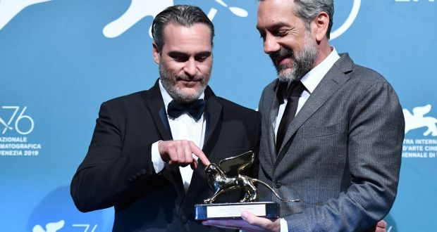 Actor Joaquin Phoenix and director  Todd Phillips of Joker, with the  Golden Lion award for best  film at the  Venice Film Festival. Photograph:   Alberto PIzzoli/ AFP/Getty Images