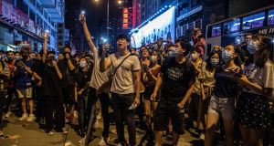 Pro-democracy demonstrators sing while blocking a road in Mong Kok, Hong Kong on Saturday. Photograph: Laurel Chor/The New York Times