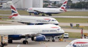 British Airways aircraft at London's Heathrow airport. The Government is being urged to intervene in the dispute between pilots and British Airways ahead of strikes which will ground flights. Photograph: Steve Parsons/PA Wire