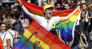 Participants carry placards and rainbow-coloured flags at Sarajevo's first gay pride parade, on  September 8th. Photograph: Fehim Demir