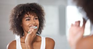 Pearly whites: brush for at least four minutes a day – two in the morning, two in the evening. Photograph: E+/iStock/Getty