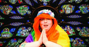 Mother of God: Alison Spittle presides over the pulpit in a colourful cape and a crown of roses