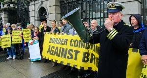 Protester Seamus McDonnell dressed as a Customs official during a rally organised by Border Communities against Brexit on Monday. Photograph: Gareth Chaney/Collins