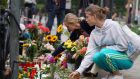 Women lay flowers at the site of a car accident in Berlin. Photograph: EPA