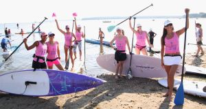 Paddle Diva team at the Hamptons Paddle for Pink race to benefit the Breast Cancer Research Foundation in Sag Harbor, New York. Anne Boyer seizes  the language and political economy of illness. Photograph: Sonia Moskowitz