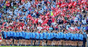 Dublin stand during the national anthem ahead of last year's Women's All-Ireland Final. Photo: Tommy Dickson/Inpho