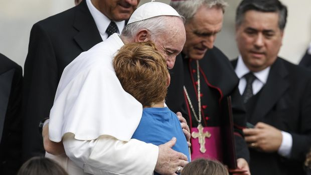 Pope Francis hugs a child during his weekly general audience in St Peter's Square at the Vatican on August 28th. Photograph: Fabio Frustaci/EPA
