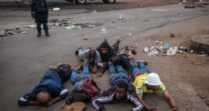Arrested residents of Johannesburg's Katlehong township lay on the ground on September 5th as South Africa's financial capital is hit by a new wave of anti-foreigner violence. Photograph: Michele Spatari/AFP/Getty Images