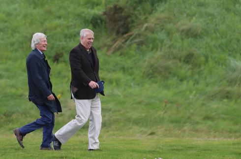 ON THE GREEN: Prince Andrew, the Duke of York, with solicitor Paul Tweed as he attends the Duke of York Young Champions Trophy golf tournament at the Royal Portrush Golf Club in Co Antrim. Photograph: Liam McBurney/PA Wire