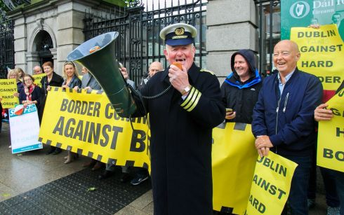 NO HARD BORDER: Protester Seamus McDonnell, dressed as a Customs official, during a rally organised by Border Communities against Brexit over British prime minister Boris Johnson's plans for achieving Brexit, outside Leinster House in Dublin. Photograph: Gareth Chaney/Collins
