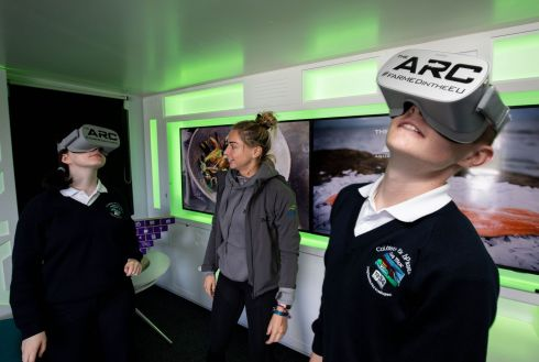 VIRTUAL AQUACULTURE: Aine O'Donnell of Bord Iascaigh Mhara (centre) with students of Coláiste na bPiarsach, Ros Muc, Co Galway - Roisin ni Eidhin and Eamon Ó Flatharta -  at BIM's mobile aquaculture remote classroom (ARC) at the Lá na Mara Festival, Cill Chiarain, Co Galway. Photograph: Alan Place
