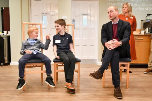 SUPPORTING STAFF: Prince William, the Duke of Cambridge, with Joseph Dowden (6), from Surrey, and Oliver Myers (10), from Leeds, during a visit to the Fire Fighters Charity's Harcombe House centre in Chudleigh, Devon, to hear about support it provides to fire and rescue services staff. Photograph: Ben Birchall/PA Wire