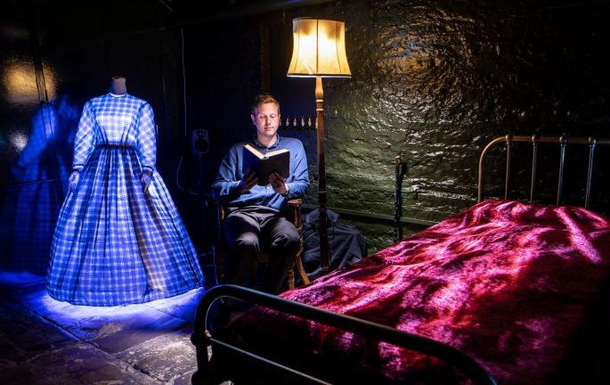MY LIGHT IS SPENT: Museum worker Harry Jelley reads as part of the How My Light Is Spent installation by Frank Cottrell-Boyce at the Bronte Parsonage Museum in Haworth, West Yorkshire, England. The installation explores the memories of the Bronte sisters' father, Patrick, as he recovered from a cataract operation. Photograph: Danny Lawson/PA Wire