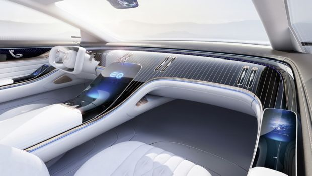 Its interior is large and white, with a dashboard panelled in wood that harks to luxury wooden lake boats