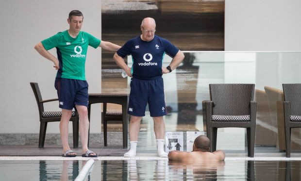 Physio Keith Fox and masseur Willie Bennett with Simon Zebo at an Ireland rugby squad pool recovery session at the Conrad Tokyo in 2017. Photograph: Ryan Byrne/Inpho