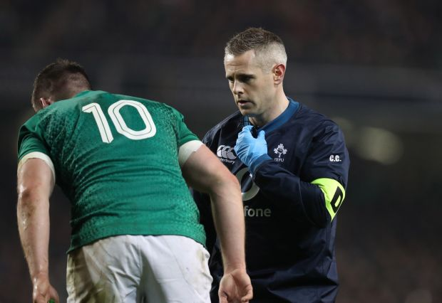Team doctor Ciaran Cosgrave checks over Johnny Sexton during a clash with the All Blacks last November. Photograph: Billy Stickland/Inpho