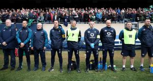 Some of Ireland's backroom team of Ger Carmody, Jason Cowman, Willie Bennett, David Hanley, Keith Fox, Dr Ciaran Cosgrave, Dave Revins, Richie Murphy and John Moran pitchside at Solider Field, Chicago in November 2018. Photograph: Dan Sheridan/Inpho