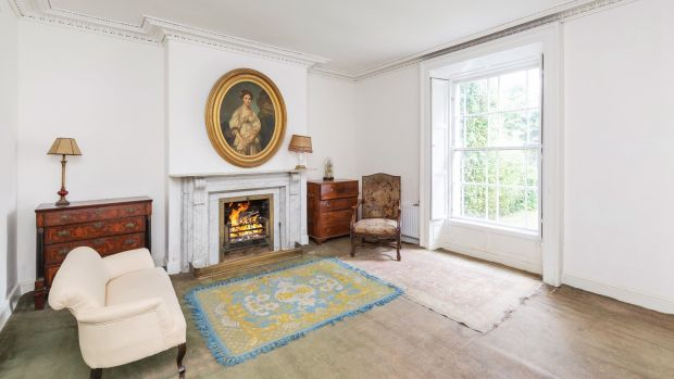 The drawingroom features a large white marble fireplace
