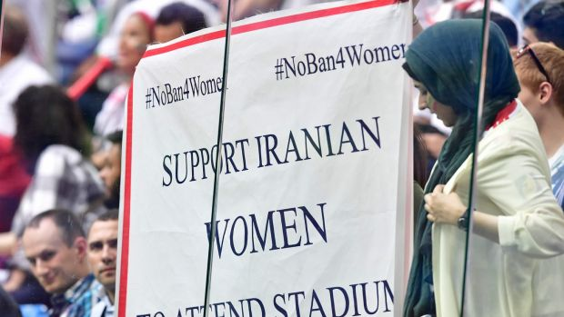 Woman hold a protest sign during the Morocco-Iran match at last year's World Cup in Russia. Photograph: Giuseppe Cacace/AFP/Getty Images