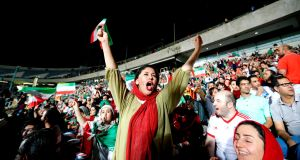 An Iranian woman cheers while watching the World Cup Group B match between Portugal and Iran at Azadi stadium in Tehran in June 2018. Photograph:  Atta Kenare/AFP/Getty Images