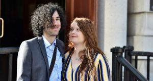 Emma DeSouza and her husband Jake at Belfast High Court on Tuesday. Ms DeSouza applied for a residence card for her US-born husband Jake using her Irish passport in December 2015 which the British Home Office rejected, saying she was British.   Photograph: Colm Lenaghan/Pacemaker
