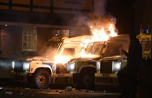 DERRY STANDOFF: PSNI landrovers after being hit with petrol bombs in the Creggan area of  Derry following a long series of police searches in the area, as part of investigations into dissident republican activity. Photograph: Trevor McBride