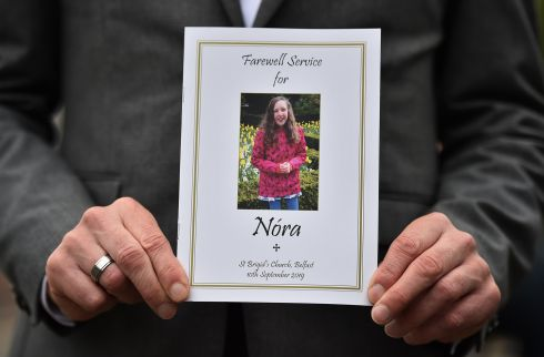 FOND FAREWELL: An order of service card for the funeral of Nora Quoirin is displayed at St Brigid's Church, Derryvolgie Avenue, Belfast. The 15-year-old died in Malaysia last month after going missing while on holiday with her family. Her body was discovered after a 10-day search. Photograph: Charles McQuillan/Getty