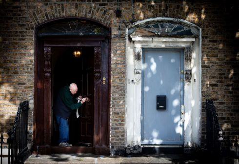 RARE OUL' TIME: A householder polishes his brass letterbox at a period home in Dublin city. Photograph: Tom Honan