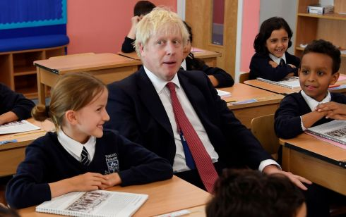 TAKING INSTRUCTION: British prime minister Boris Johnson attends a class during his visit to Pimlico Primary school in London. Photograph: Toby Melville/AFP/Getty